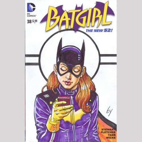 batgirl checks her phone.jpg